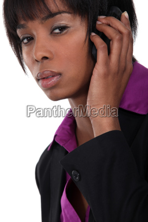 afro american businesswoman talking on her