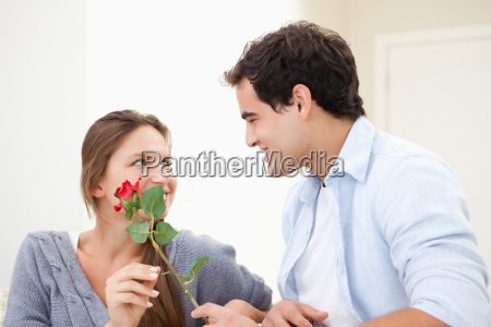 man offering a rose to a