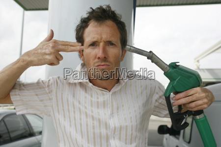 man at petrol pump