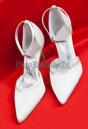 pair of white womens shoes