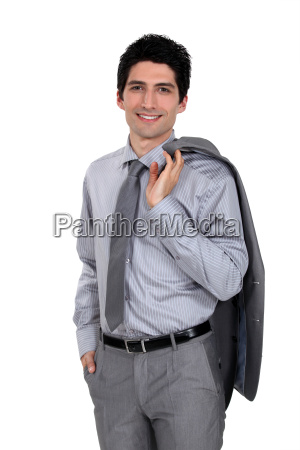 confident businessman with jacket draped over
