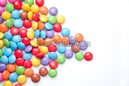 heap of candies multi coloured against
