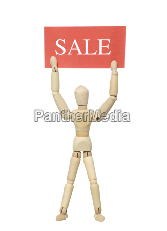 doll with sale sign