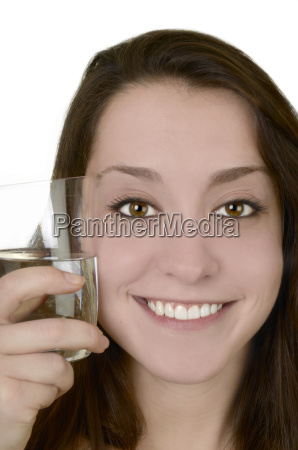 young woman with water glass smiles