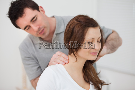 smiling woman sitting while being massaged