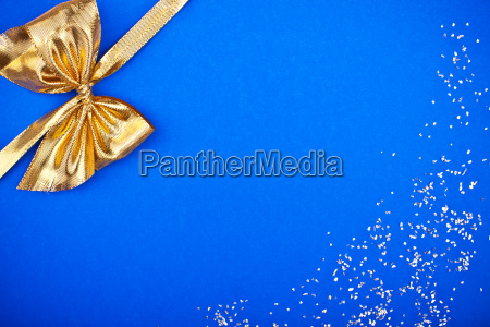 blue greeting card with golden bow