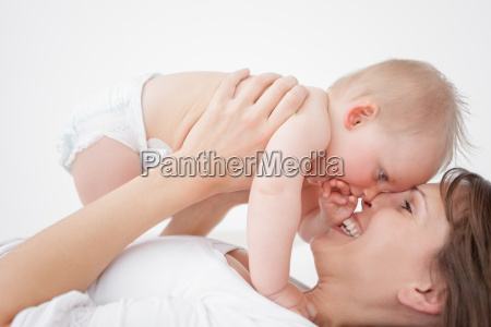 happy mother holding her daughter while