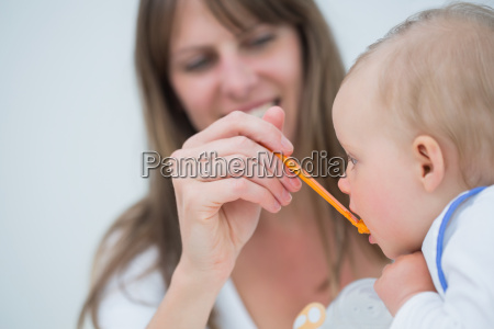 mother feeding to a baby in