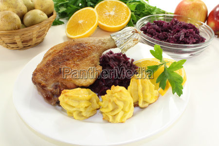 duck leg with red cabbage
