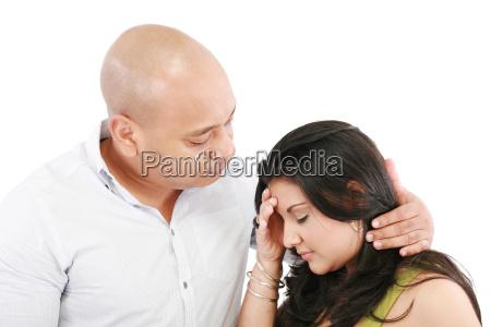 husband comforts young wife isolated on