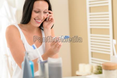 smiling woman positive pregnancy test result