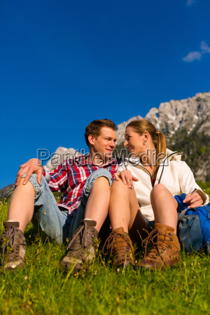 happy couple hiking in mountains