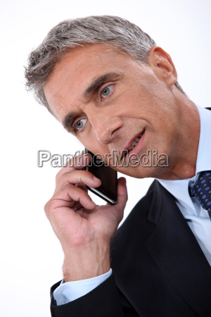 director talking on phone on white