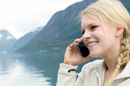 young blond woman on the phone
