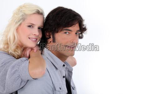 couple stood together on white background