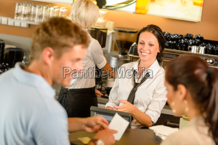 couple paying bill at cafe cash