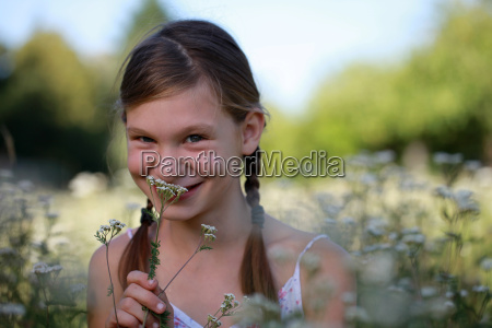 girl on a flower meadow