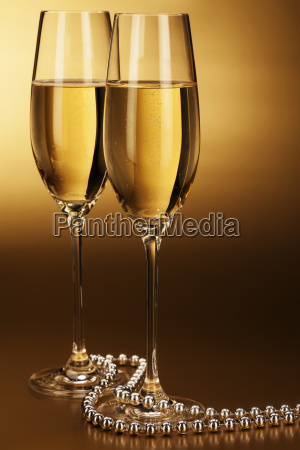 two glasses with champagne and silver