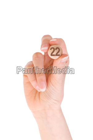 22 bingo ball in the hand