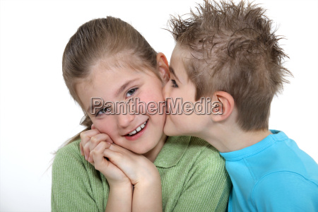 boy kissing a girl on the
