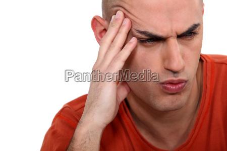 man grimacing white background