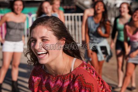 laughing teenage female