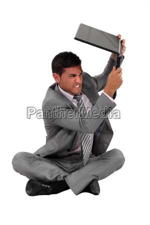 a businessman about to smash his