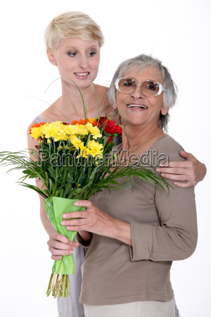 young woman giving a senior lady