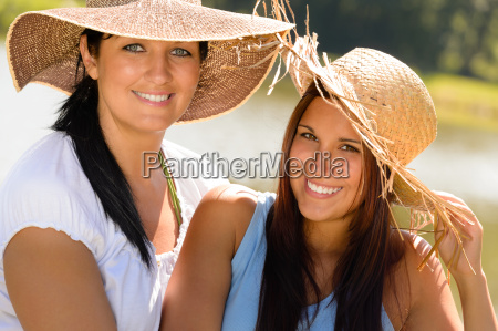 mother and daughter relaxing outdoors summer