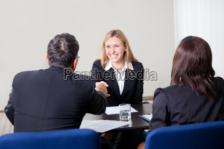 female shaking hands at the job