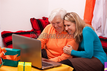 senior and young woman sitting on