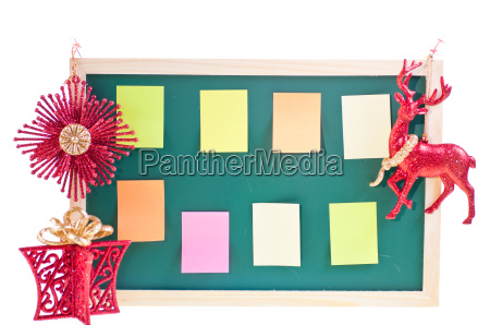 christmas notice board with ornaments over