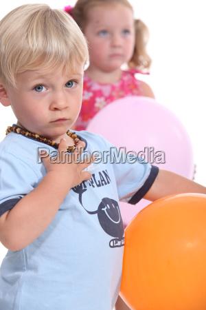 young boy wearing an amber teething