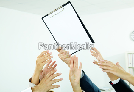 reaching out for paper