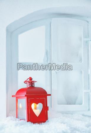 christmas lantern on a snowy windowsill