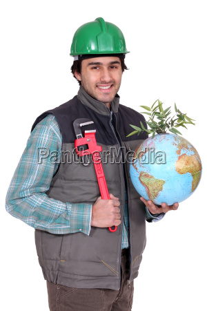 portrait of manual worker holding globe