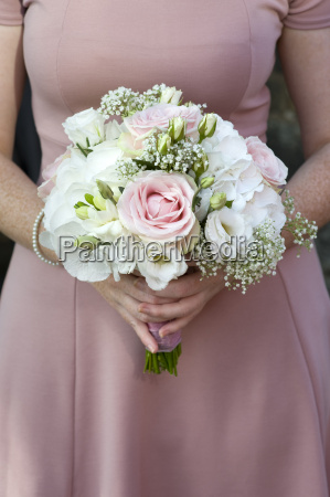 bridesmaid holding a wedding bouquet of