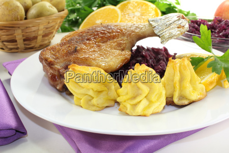 fresh duck leg with red cabbage