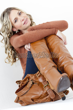 portrait of sitting woman wearing fashionable