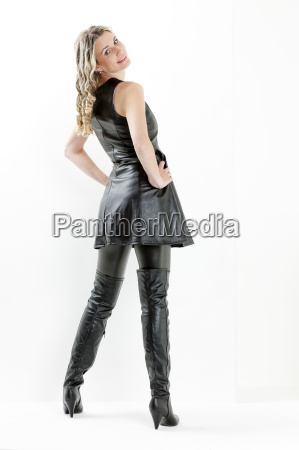 standing woman wearing black dress and