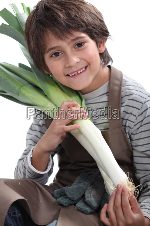 little boy gardener with leeks