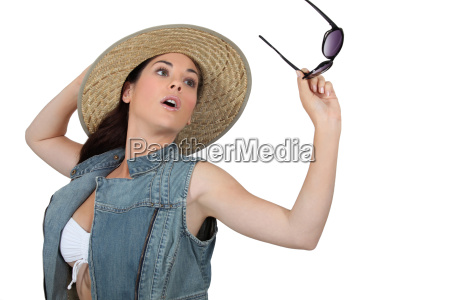 young woman with straw hat and