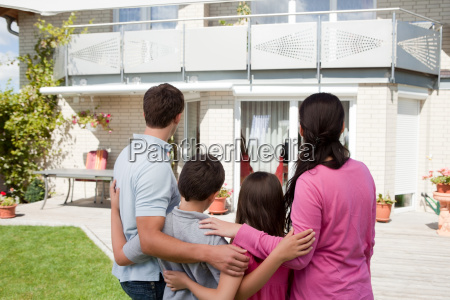 young family standing in front of