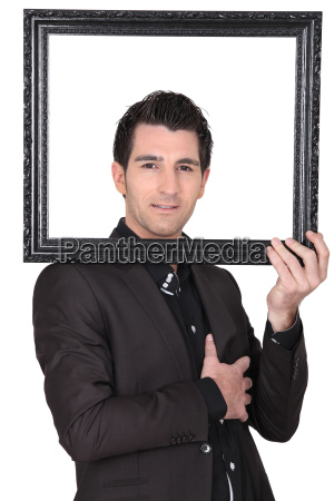 young businessman looking through a picture