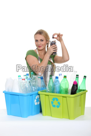 woman recycling old plastic bottles