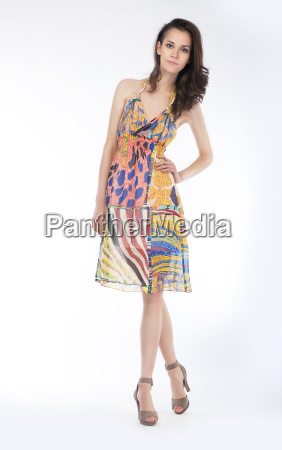 sensual young woman in trendy dress