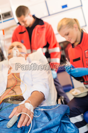 sick patient with paramedic in ambulance