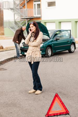 upset woman on the phone car