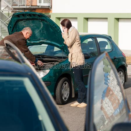 car troubles man help woman defect
