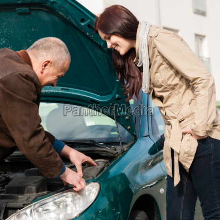 man working on repairing a womans